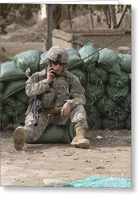 A U.s. Army Soldier Talks On A Radio Greeting Card by Stocktrek Images