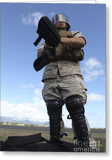 A U.s. Marine Dons Riot Gear For Drills Greeting Card by Stocktrek Images