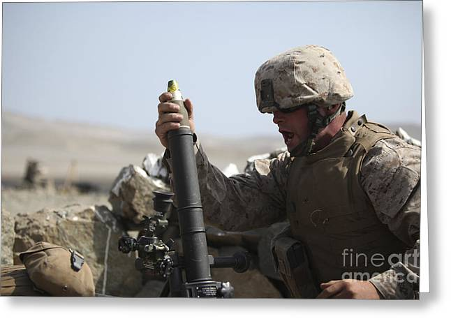 A U.s. Marine Loads A Mortar Greeting Card by Stocktrek Images