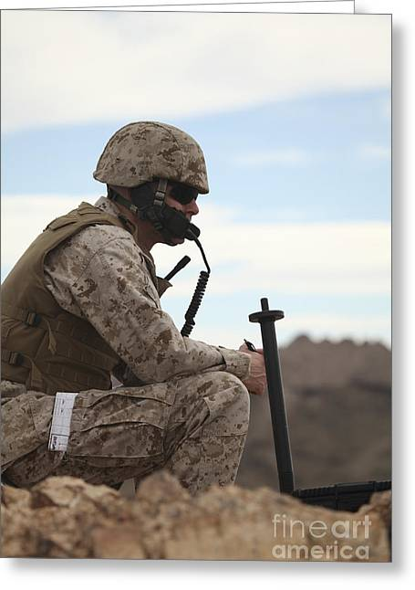 A U.s. Marine Uses A Field Phone Greeting Card by Stocktrek Images