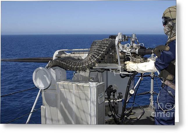 A U.s. Navy Gunners Mate Firing Greeting Card by Stocktrek Images