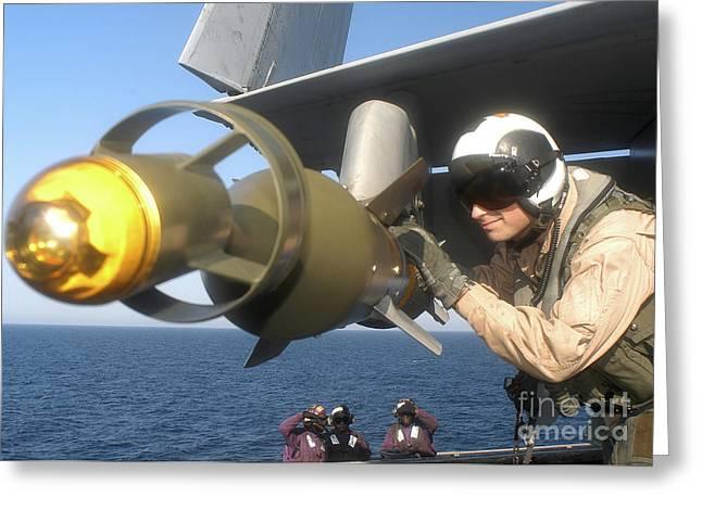 A U.s. Navy Pilot Examines A Gbu-12 Greeting Card