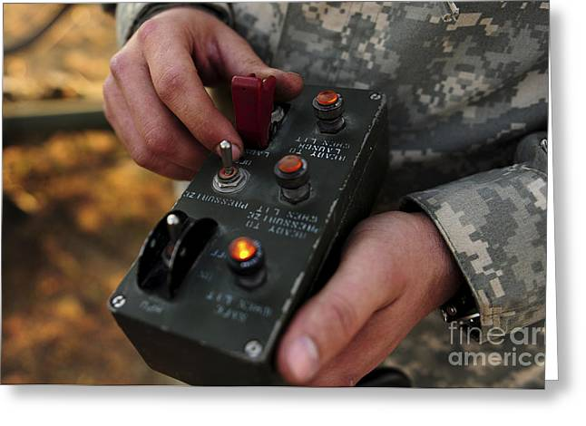 A U.s. Soldier Hits The Button Greeting Card by Stocktrek Images