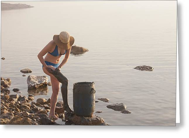A Woman Smears Therapeutic Dead Sea Mud Greeting Card by Taylor S. Kennedy