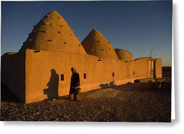 A Woman Walks Past A Sunlit Mud Brick Greeting Card by James L. Stanfield