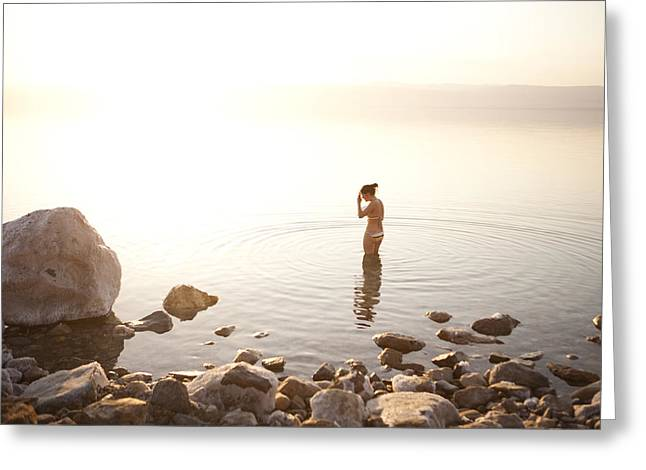 A Young Woman Wades Into The Dead Sea Greeting Card by Taylor S. Kennedy