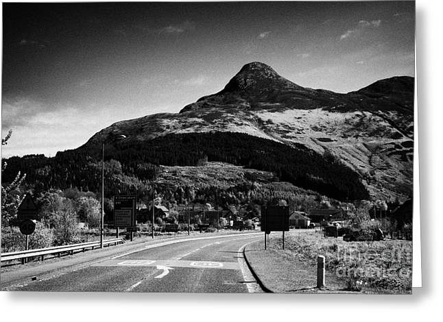 A82 Road Into Glencoe With The Pap Of Glencoe In The Highland Of Scotland Uk Greeting Card by Joe Fox