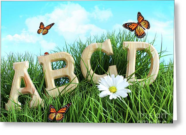 Abc Letters With Daisy In Grass Greeting Card by Sandra Cunningham