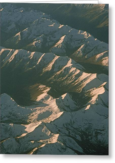 Aerial View Of Snowcapped Mountain Greeting Card by Gordon Wiltsie