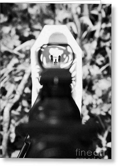 Aiming An M4 Rifle Sight At A Paper Target On A Firing Range Greeting Card