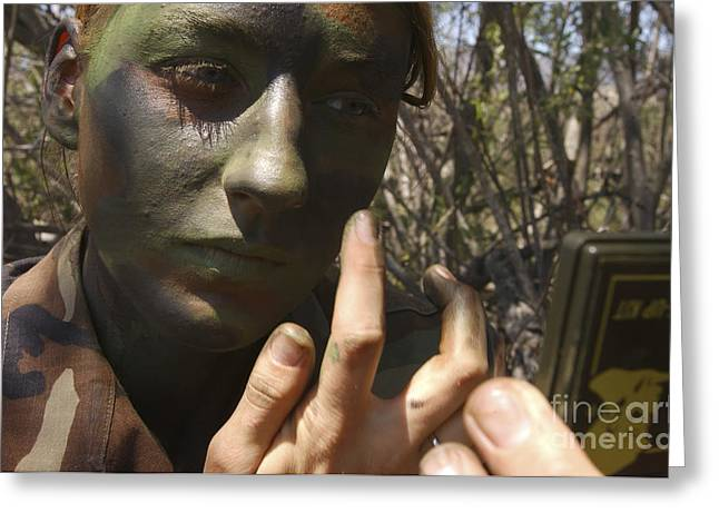 Airman Applies Camouflage Paint Greeting Card by Stocktrek Images
