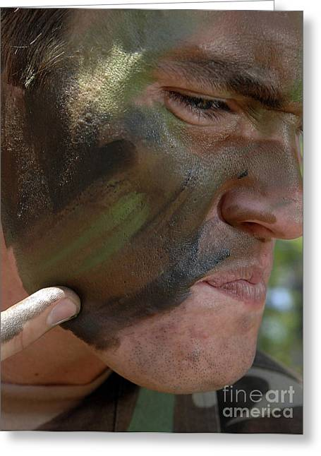 Airman Applies War Paint To His Face Greeting Card by Stocktrek Images
