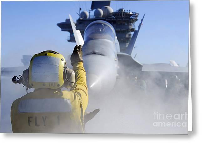 Airman Directs An Fa-18 Hornet Greeting Card