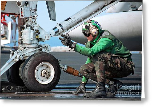 Airman Guides An Fa-18 Hornet Onto Greeting Card