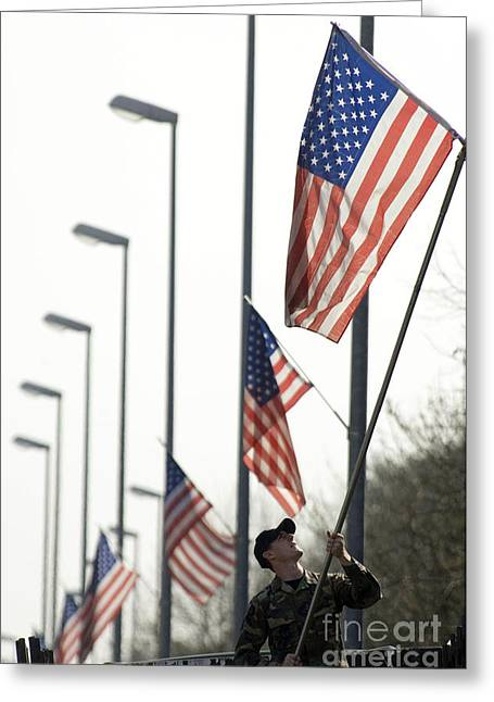 Airman Posts A New Flag On The Main Greeting Card by Stocktrek Images