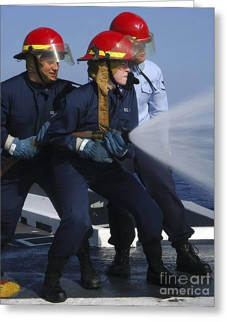 Airmen Participate In A Fire Hose Team Greeting Card