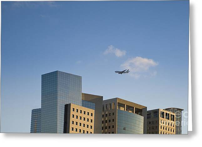 Airplane Flying Over Office Buildings Greeting Card by Noam Armonn