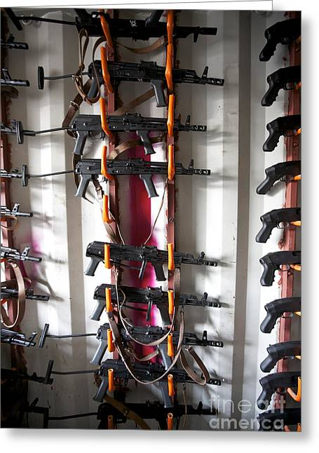 Akm Assault Rifles Lined Up On The Wall Greeting Card by Terry Moore