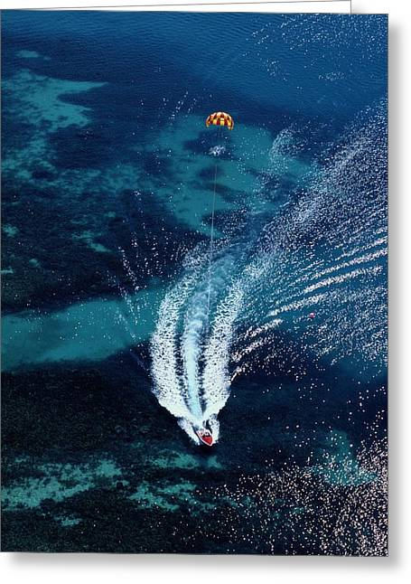 An Aerial View Of A Motorboat Towing Greeting Card by Paul Chesley