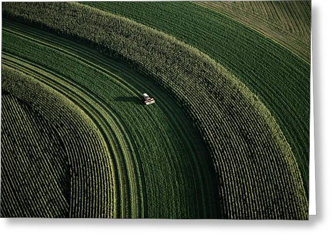 An Aerial View Of A Tractor On Curved Greeting Card by Paul Chesley