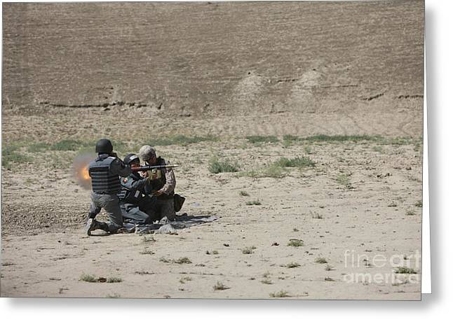 An Afghan Police Studen Fires Greeting Card by Terry Moore