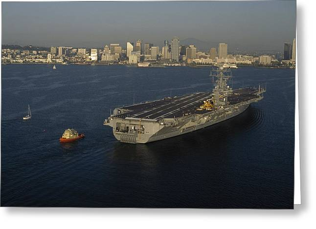 An Aircraft Carrier With The Skyline Greeting Card by Phil Schermeister