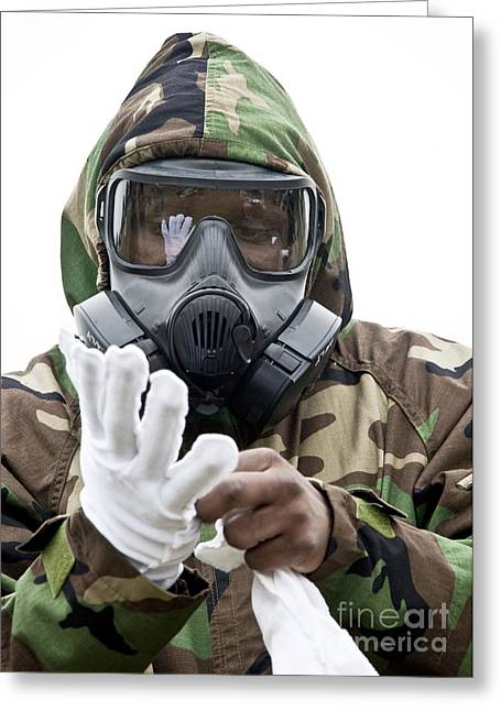 An Airman Puts On Protective Chemical Greeting Card by Stocktrek Images