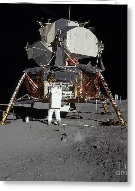 An Apollo 11 Astronaut In Front Greeting Card by Stocktrek Images