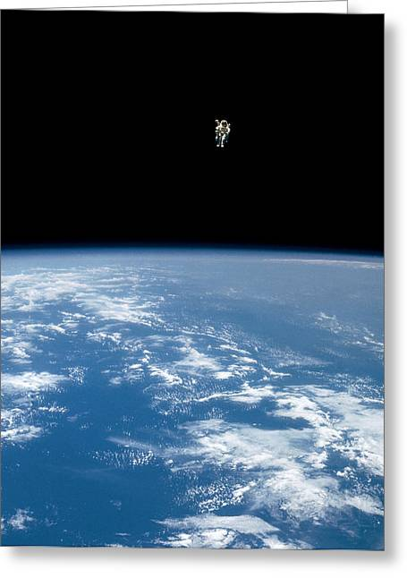 An Astronaut Propelled Above The Earth Greeting Card by Nasa