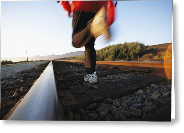 An Athlete Runs On Railroad Tracks Greeting Card by Joy Tessman