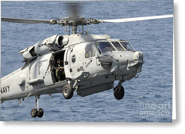 An Hh-60h Sea Hawk Helicopter Prepares Greeting Card