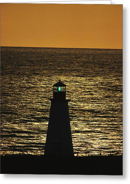 An Illuminated Silhouetted Lighthouse Greeting Card by Michael Melford