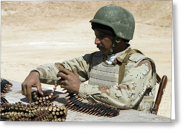 An Iraqi Army Soldier Prepares Belts Greeting Card by Stocktrek Images