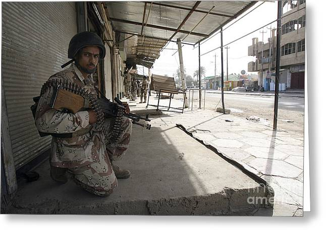 An Iraqi Solider Holds Security Greeting Card by Stocktrek Images
