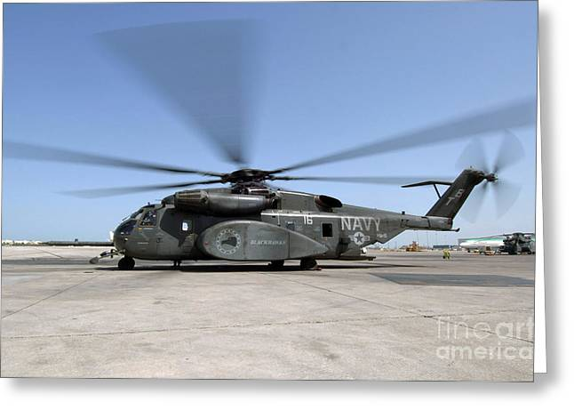 An Mh-53e Sea Dragon Helicopter Sits Greeting Card by Stocktrek Images