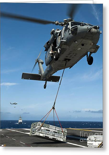 An Mh-60s Sea Hawk Helicopter Lowers Greeting Card by Stocktrek Images