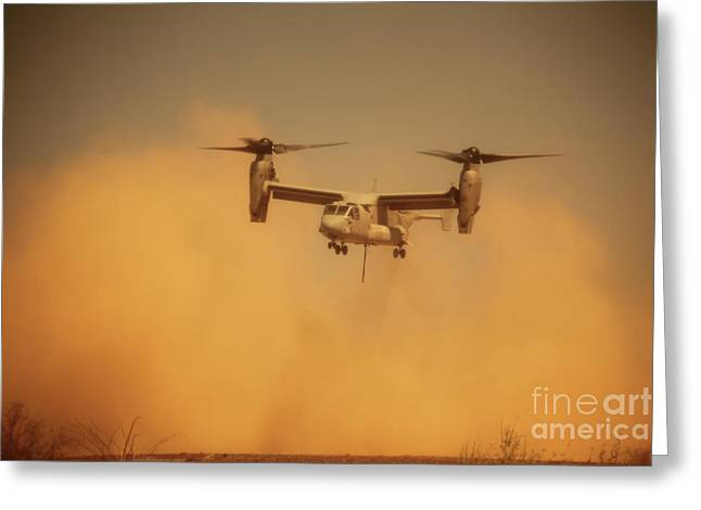 An Mv-22 Osprey Aircraft Blows Dust Greeting Card by Stocktrek Images