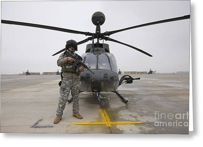 An Oh-58d Kiowa Warrior Pilot Stands Greeting Card by Terry Moore