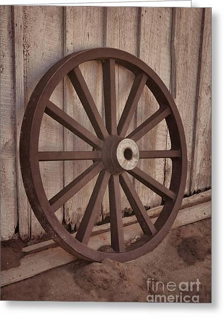 An Old Wagon Wheel Greeting Card by Donna Greene