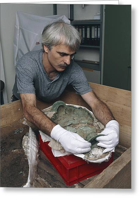 Archaeologist Reconstructing A Bronze Celtic Pot Greeting Card by Volker Steger