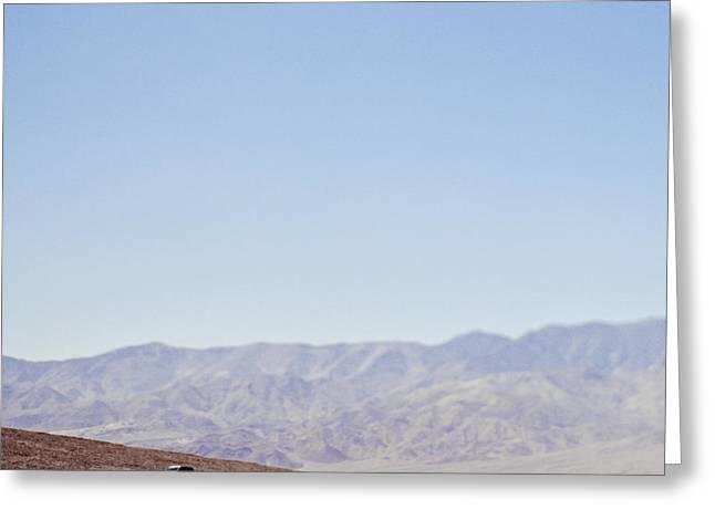 Automobile Driving Through Desert Greeting Card by Eddy Joaquim