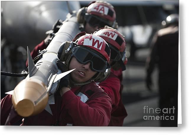 Aviation Ordnancemen Carry An Greeting Card by Stocktrek Images