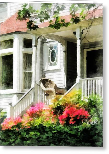Azaleas By Porch With Wicker Chair Greeting Card by Susan Savad