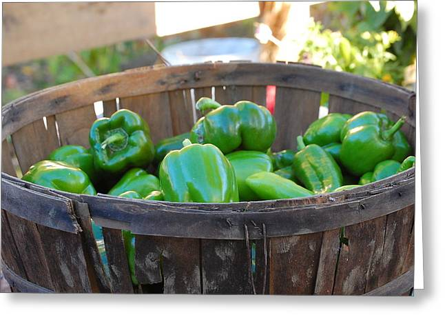 Greeting Card featuring the photograph Basket Of Green Peppers by Mary McAvoy