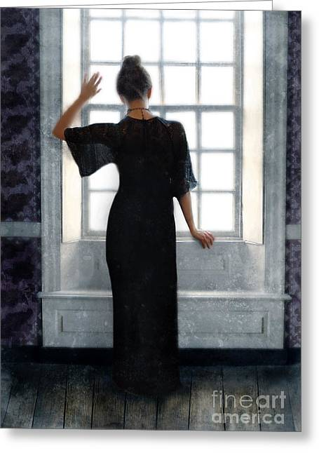 Beatiful Young Woman In A Black Gown Standing By The Window Greeting Card