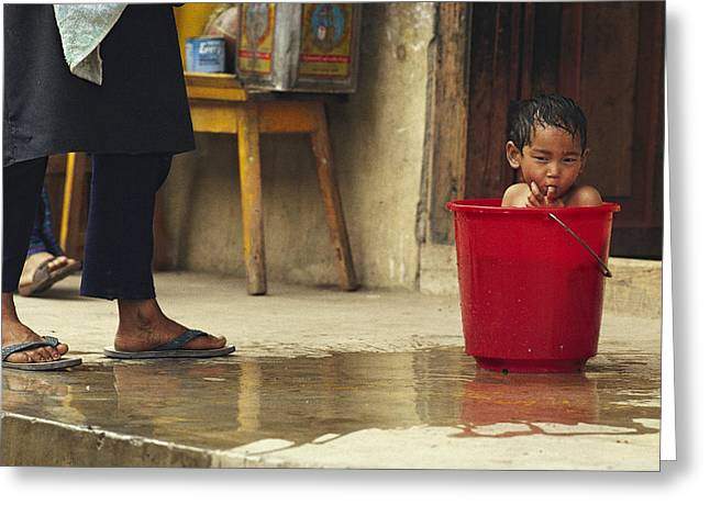 Bhutanese Boy Bathing In A Bucket Greeting Card by James L. Stanfield