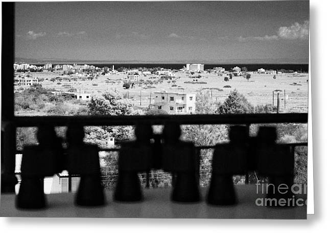 binoculars at observation point for tourists overlooking the UN buffer zone in cyprus Greeting Card by Joe Fox