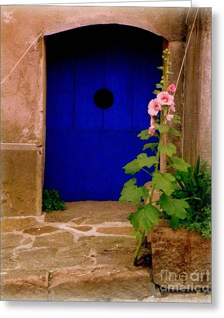 Blue Door And Pink Hollyhocks Greeting Card