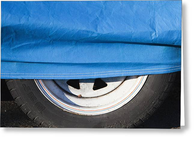 Blue Tarp And Car Wheel Greeting Card by Paul Edmondson