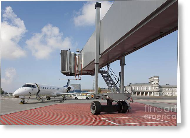 Boarding Bridge Leading To A Parked Plane Greeting Card by Jaak Nilson